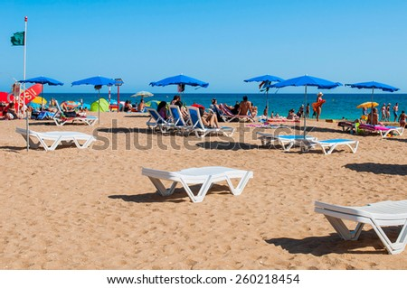ALBUFEIRA, PORTUGAL - AUGUST 29: unidentified people enjoying a sunny day at beach in Algarve on August 29, 2011 in Albufeira, Portugal. It is the most touristic place in the region during all year. - stock photo