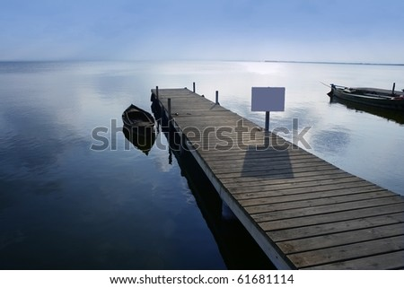 Albufera lake wetlands pier with boat in Valencia Spain