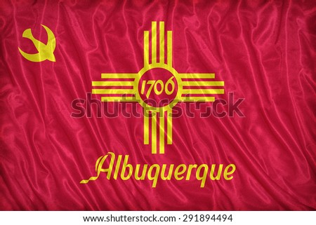 Albuquerque ,New Mexico flag pattern on the fabric texture ,vintage style - stock photo