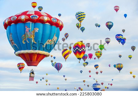 ALBUQUERQUE, NEW MEXICO - OCT 11: Balloons fly over Albuquerque on October 11, 2014 in Albuquerque, New Mexico. Albuquerque balloon fiesta is the biggest balloon event in the world. - stock photo