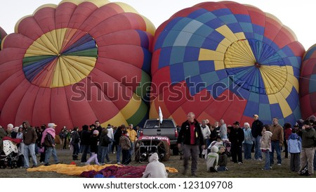ALBUQUERQUE, NEW MEXICO - OCTOBER 9: Balloonists get ready to fly over Albuquerque on October 9, 2010 in Albuquerque, New Mexico. Albuquerque balloon fiesta is the biggest balloon event in the the world. - stock photo