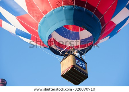 ALBUQUERQUE, NEW MEXICO - OCTOBER 6, 2015: Balloons fly over Albuquerque, New Mexico. International balloon fiesta is the biggest hot air balloon event in the world.