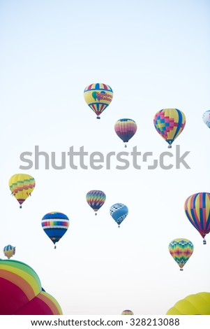 ALBUQUERQUE, NEW MEXICO - OCTOBER 6, 2015: Balloons fly over Albuquerque, New Mexico. International balloon fiesta is the biggest hot air balloon event in the world. Mass Ascension.