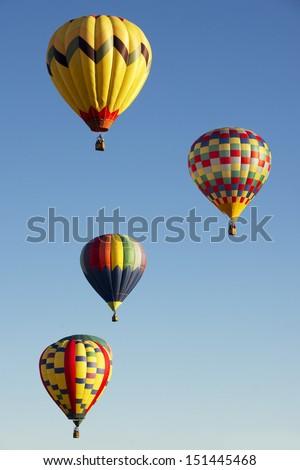 ALBUQUERQUE, NM - OCTOBER 10: A group of hot air balloons soar at Albuquerque International Hot Air Balloon Fiesta October 10, 2012 in Albuquerque, NM. - stock photo