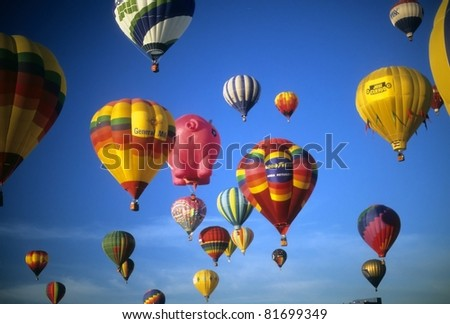 ALBUQUERQUE - OCT 8 -  Tourists ride hot air balloons during a mass ascension at the International Balloon Festival,  on Oct 8, 1992 in Albuquerque, New Mexico - stock photo