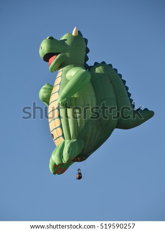 ALBUQUERQUE - OCTOBER 7: Dragon shaped hot air balloon takes flight during the International Balloon Fiesta in Albuquerque NM on October 7, 2016