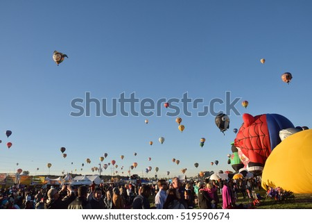 ALBUQUERQUE - OCTOBER 7: Hundreds of hot air balloons take flight during the International Balloon Fiesta in Albuquerque NM on October 7, 2016