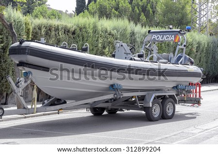 ALCALA DE HENARES, SPAIN - AUGUST 29th 2015: Boat -Zodiac Hurricane 733-, over a trailer, of spanish police, during a show, in Alcala de Henares, on August 29th 2015.