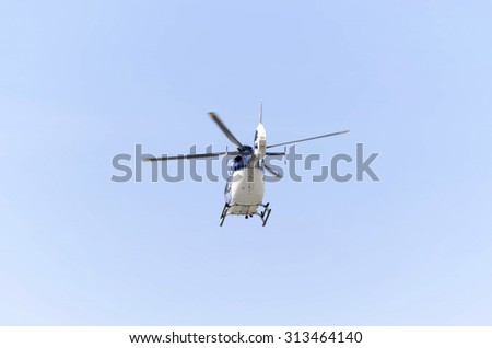 ALCALA DE HENARES, SPAIN - AUGUST 29th 2015: Helicopter, of spanish police,is taking off with parachutists inside, during an exhibition of spanish armed forces,in Alcala de Henares,on August 29th 2015 - stock photo
