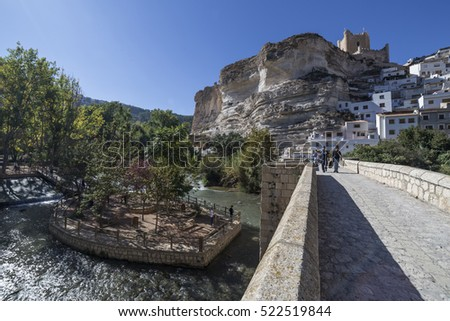Alcala del Jucar, Spain - October 29, 2016: Roman bridge, located in the central part of the town, to its passage by the river Jucar, take in Alcala del Jucar, Spain