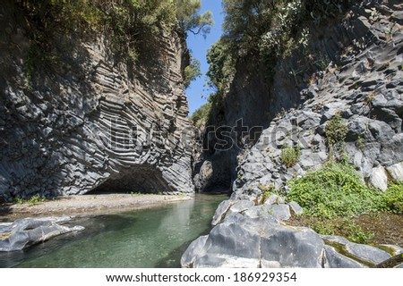 Alcantara river flowing in the rock canyon, Sicily, Italy.
