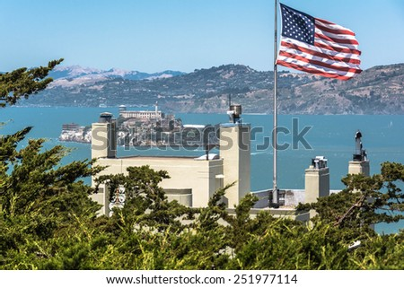 Alcatraz and the American flag San Francisco,California,USA - June 18,2014 : A view of Alcatraz from above