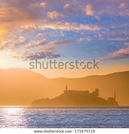 Alcatraz island penitentiary at sunset and backlit in San Francisco, California, USA. - stock photo