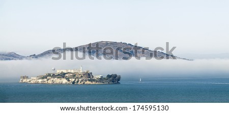 Alcatraz prison in fog panorama, San Francisco, California