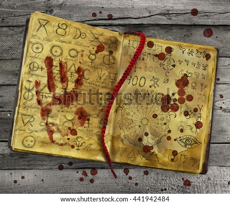 Alchemy book with bloody hand print and drops lying on wooden table. Halloween still life, black magic ritual with mysterious occult and esoteric symbols - stock photo