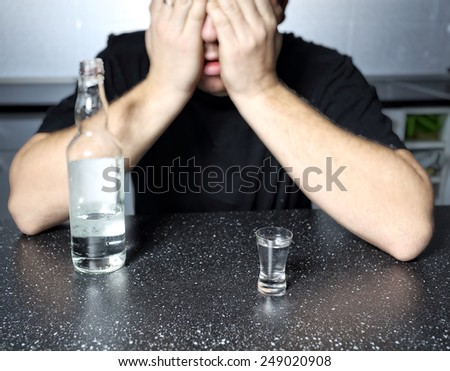 alcohol abuse - drunk man with vodka - stock photo