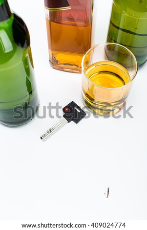 Alcohol and car keys - stock photo