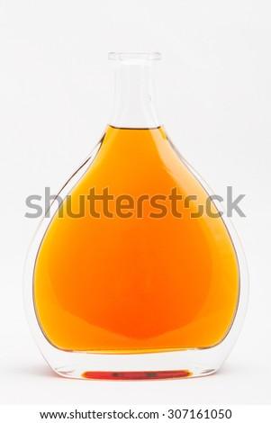 alcohol bottles on white background Bottle of cognac isolated - stock photo