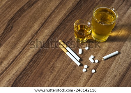 Alcohol Cigarettes Pills - stock photo