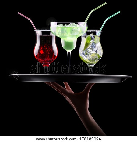 alcohol cocktail set on a waiter hand. Berry cooler cocktail, martini, mojito,  Pina Colada - stock photo