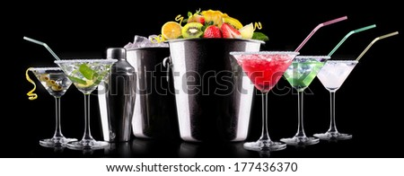 alcohol cocktail set with tasty summer fruits. Berry cooler cocktail, martini, mojito,  Pina Colada