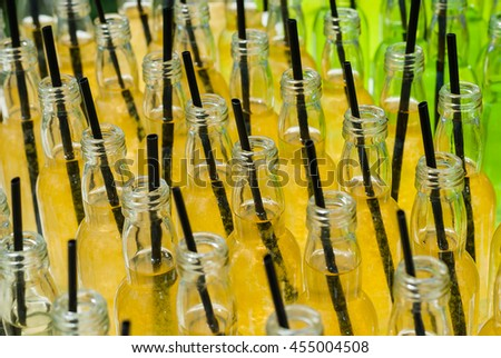 Alcohol cocktails, shots in glass bottles. Row of many alcohol tasty shots with straws in small bottles. Creative cocktails. Unusual alcohol in bar, many, plenty of drinks for party., catering, event - stock photo