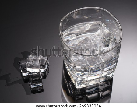 Alcohol drink and ice cube in glass