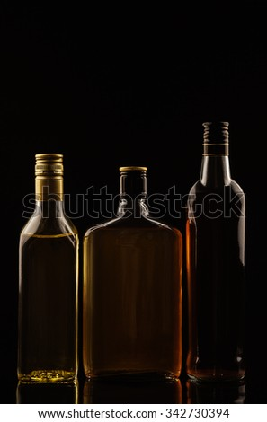 Alcohol drinks on black background without tags - stock photo