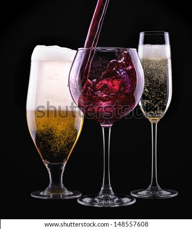 alcohol drinks set isolated on a black background - beer,wine,champagne - stock photo