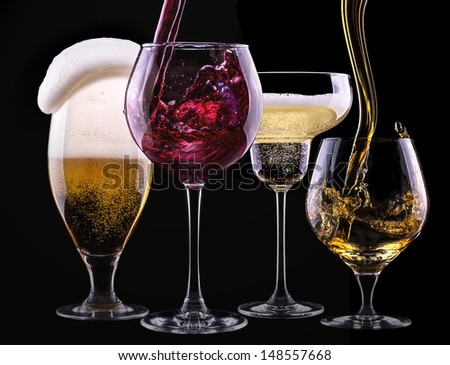 alcohol drinks set isolated on a black background - beer,wine,champagne,scotch - stock photo