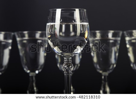 Alcohol glass set on black background.