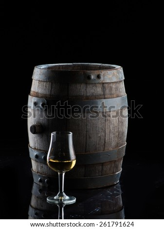 alcohol in a wooden barrel - stock photo