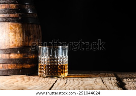 Alcohol in large round glass, Whiskey, Brandy, Cognac - stock photo