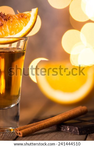 Alcohol in shot glass - stock photo