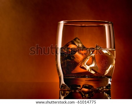 Alcohol on the rocks, one glass - stock photo
