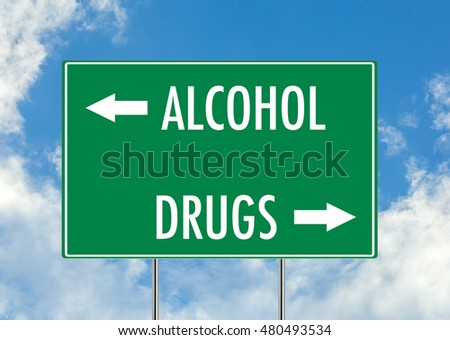 Alcohol vs drugs green road sign over blue sky background. Concept road sign collection.