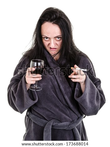 alcoholic, aggressive woman drinking red wine and smoking  - stock photo