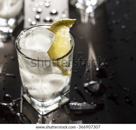 alcoholic beverage. cocktail vodka in a glass with ice and lime