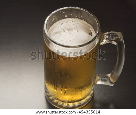 Alcoholic beverage in a glass/Mug of Beer/Sparkling bubbles in a refreshing drink - stock photo