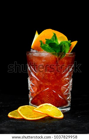 alcoholic beverage on a black background