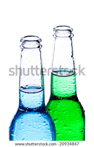 alcoholic beverages - wet bottles with blue and green liquid isolated on white - stock photo