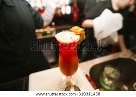 alcoholic cocktail against the background of the bar - stock photo