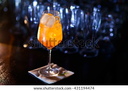 alcoholic cocktail with an orange garnish in a beautiful glass.