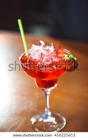 Alcoholic cocktail with strawberry.