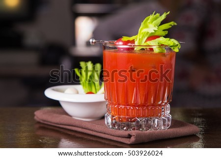 alcoholic cocktail with vodka and cold tomatoes juice in restaurant