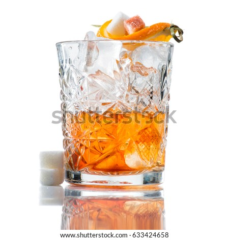 Alcoholic cocktail with whiskey, orange and a slice of sugar, isolated on white background