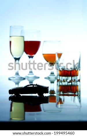 Alcoholic Drink and a toy car Photo of an alcoholic drink in a crystal glass and a toy car - stock photo