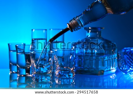 alcoholic drinks in bar on a glass table