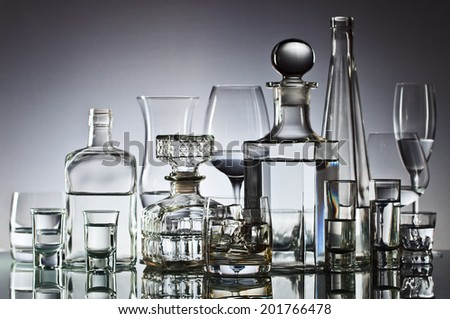 alcoholic drinks in bar on glass table  - stock photo