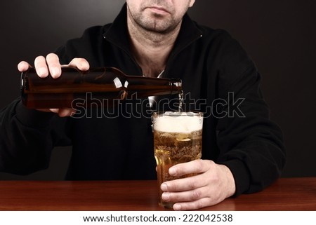 alcoholic in despair drinking beer, bad teeth - stock photo